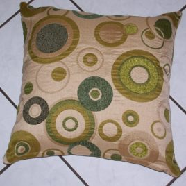 Circles cushion in green tones