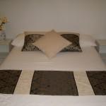 Cream cushion shown with set
